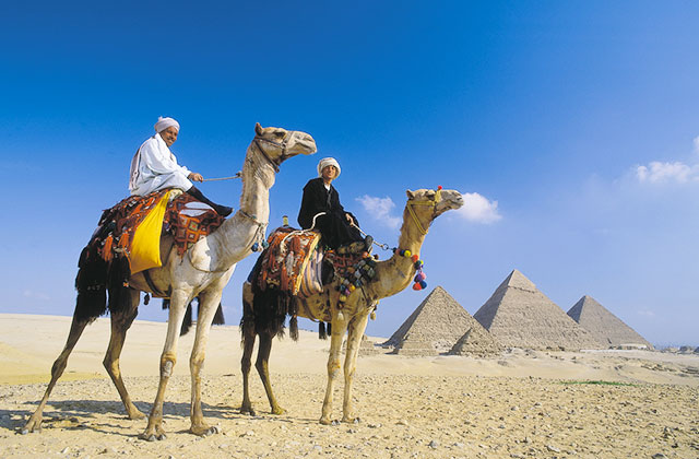 Tourist taking a camel ride