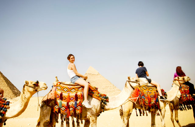 Tourists taking a camel ride