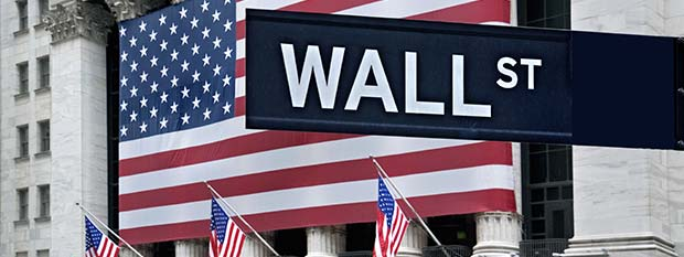 Wall Street Sign with American Flag in the Background | Things to do in New York