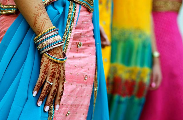 Brightly coloured saris and henna tattoo